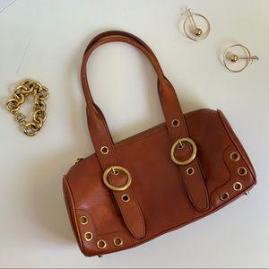 Maxx New York genuine leather grommet bag